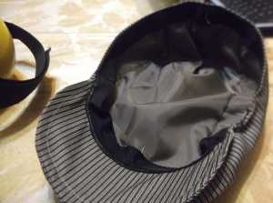 Silk liner and ribbon band complete this flat cap out of remnant material.