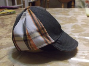 Plaid shorts and wool dress pants from Goodwill donated the necessary material for this custom fit short bill ball cap.